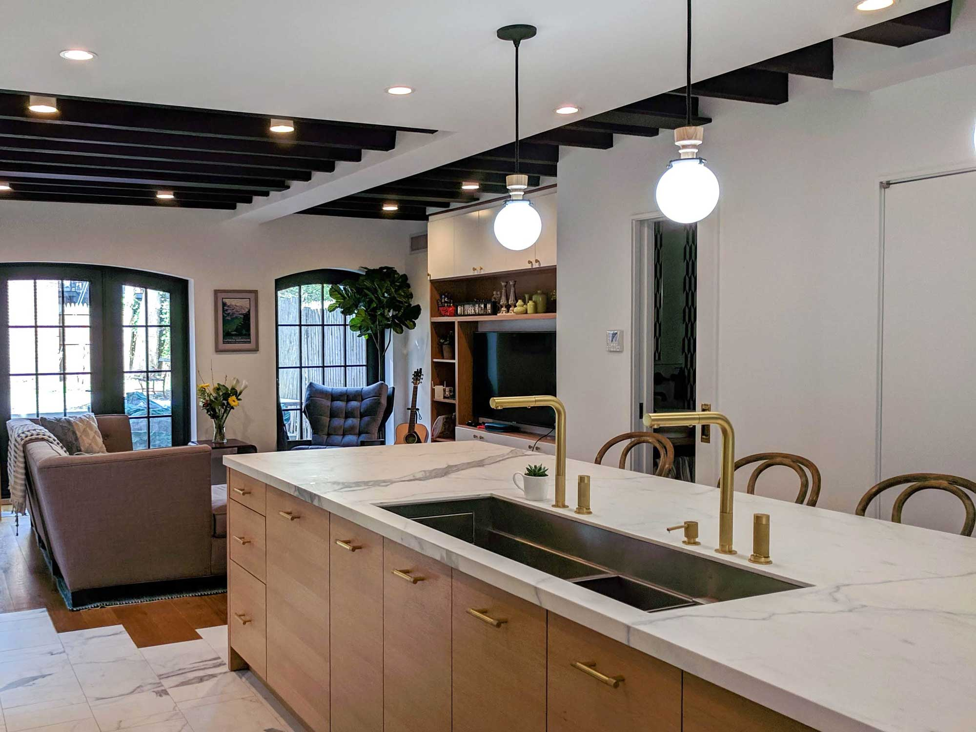 Kitchen Island with sink and pendant lighting